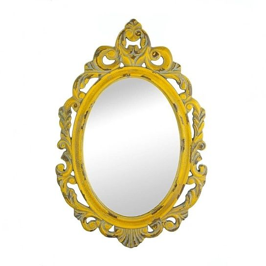 """Give your room a regal dose of style simply by adding this weathered yellow wall mirror to any room. Made to look like a timeworn treasure, the ornately carved wooden frame will brighten your space while adding to its allure.Reflective mirror: 9 3/4"""" x 14""""The color of this item may vary due to distressed finished."""