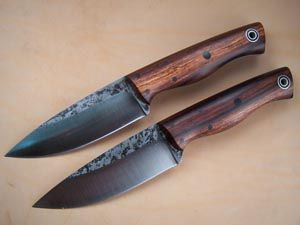 """By Andy Roy at Fiddleback Forge.  This is the Bushfinger. Its an evolution of the Ladyfinger, guardless, & without the sway in the spine. knife measures 8.5"""" long & has a 4"""" drop point blade. This one is spalted 01 steel with a convex sabergrind. The handle is black linen micarta and natural canvas micarta."""