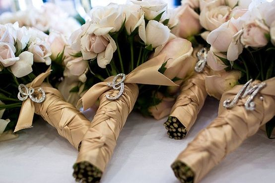 Love the rhinestone initials so bridesmaid's bouquets don't get mixed up! Also a great gift for being in the wedding.