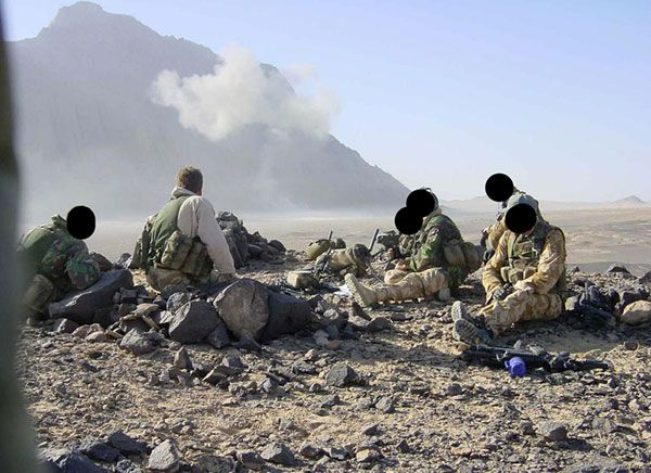 British Special Forces - SAS, SBS or SFSG soldiers - pictured observing an air strike in Afghanistan.