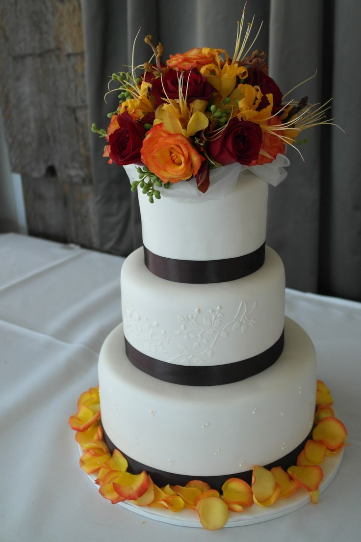 Autumn inspired flowers on 3 tier wedding cake finished with black ribbon www.casadel.com.au