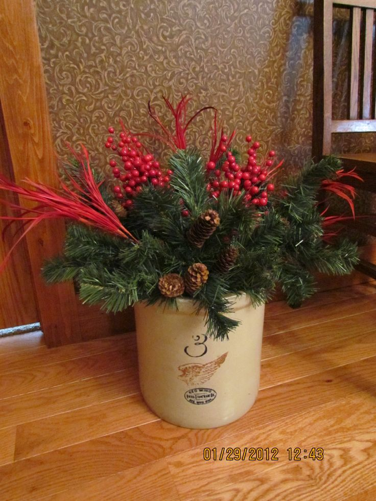 Antique 3 gallon Red Wing crock in dining room decorated w/ red/green dining room theme for Christmas