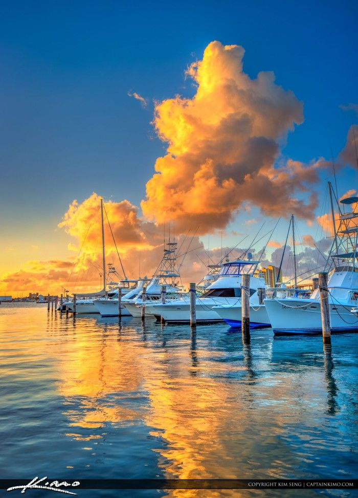 Colorful clouds at sunset over the Sailfish Marina in Singer Island Florida along the waterway. HDR image created in Photomatix Pro and Topaz software.