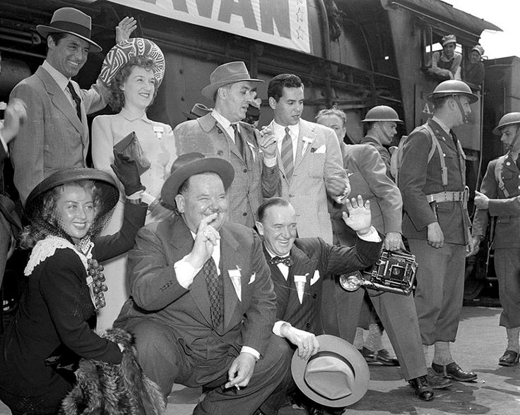 Oliver Hardy,Stan Laurel, Joan Blondell, Cary Grant, Rise Stevens, Charles-Boyer and Desi Arnaz pose with the other members of the Hollywood Victory Caravan 1942.