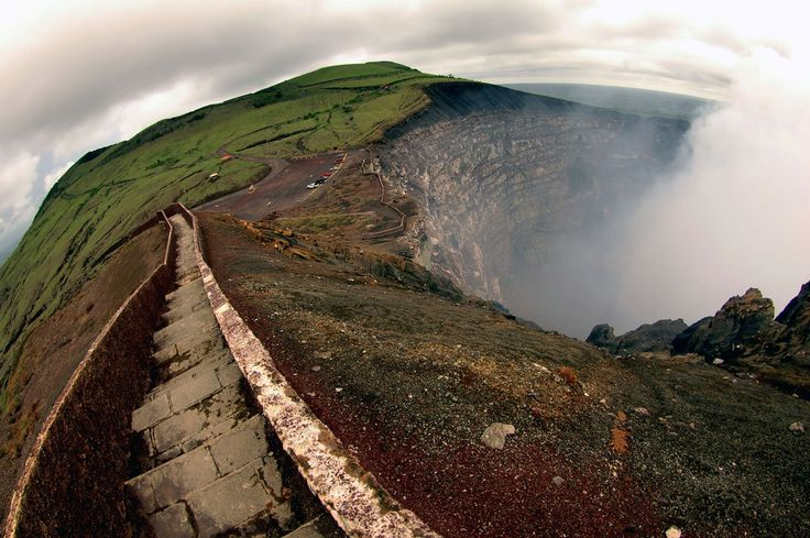View from a stone path at the edge of Volcán Masaya's steaming crater.