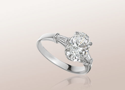 bulgari griffe solitaire ring in platinum with oval shape diamond and 2 side diamonds available