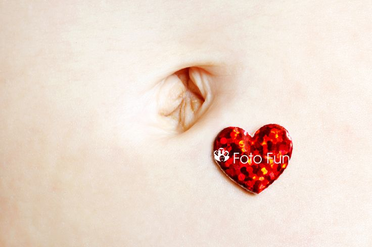 baby tummy with red heart