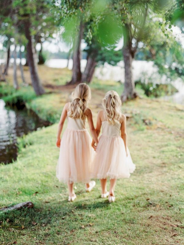 Flower girls wearing pink holding hands | 2Brides Photography on @blovedblog via @aislesociety
