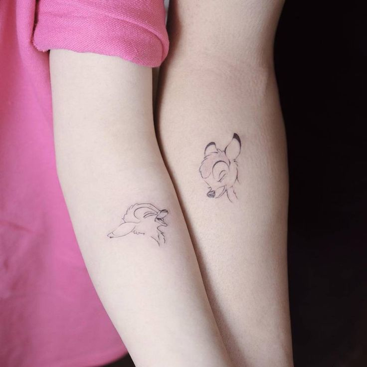 Matching Bambi tattoo on the inner forearm.