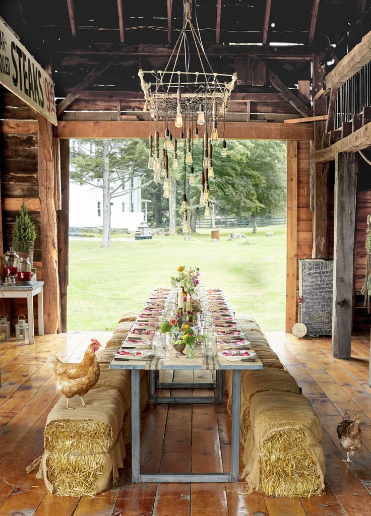 Located in Shohola, Pennsylvania, Cooper made this festive barn available to rent for weddings and special events, before recently deciding to put it on the market. Guests could even rent the adjacent farmhouse and make a weekend of it. A rustic tablescape looks outside at the barn's pretty scenery.