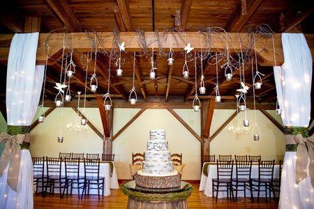 Rustic Barn Wedding Reception Hanging csndles in jars over beams