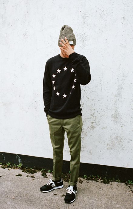Shop this look on Lookastic:  http://lookastic.com/men/looks/olive-beanie-black-and-white-crew-neck-sweater-olive-chinos-black-athletic-shoes/8070  — Olive Beanie  — Black and White Star Print Crew-neck Sweater  — Olive Chinos  — Black Athletic Shoes