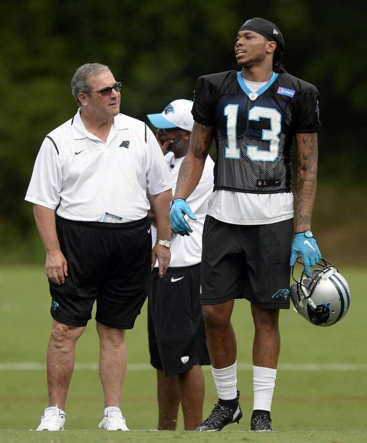 Carolina Panthers general manager Dave Gettleman talks with Kelvin Benjamin (13) during Carolina Panthers Training Camp at Wofford College in Spartanburg, SC on Sunday, August 9, 2015.