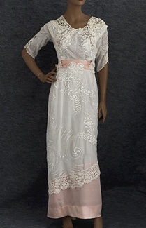 Edwardian dress with pink waist sash and hem detail.  The antique lace on this dress is beautiful