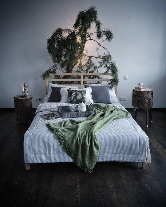 Woodsy comfy bedroom with lit, handmade headboard.