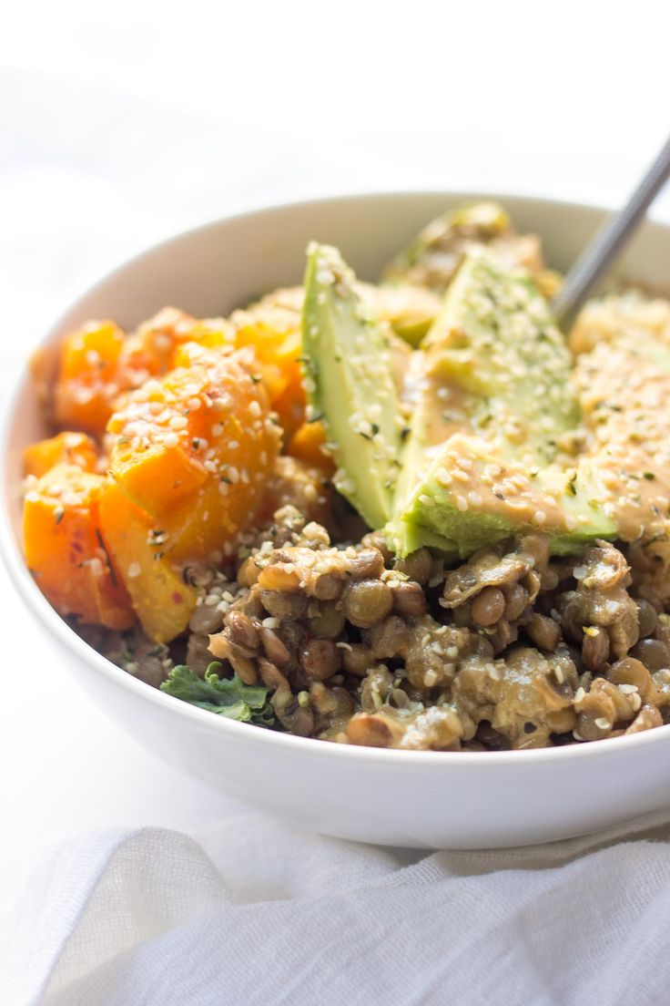 Cozy Quinoa Buddha Bowls with kale, lentils, roasted veggies and avocado -- they make the simplest plant-based meal ever!