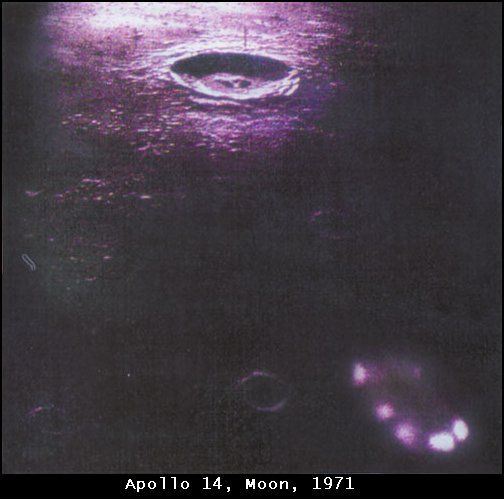 """1971 - The Moon. In this second shot, the shape of the object looks like the one of a flying saucer with lights! Reference: NASA AS14-70-9836/37. There are two avenues of thought here. First, debunkers say if these really were UFOs why would NASA release the pictures, since they are part of a conspiracy to keep this info from the pubic. Secondly, UFO proponents say that if NASA did NOT release them, then everyone would holler """"coverup,"""" and they were hiding UFOs. #aliens #nasa #moon #ufo"""
