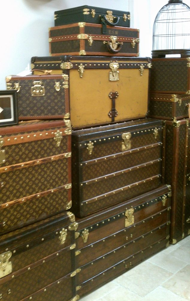 Louis Vuitton Trunks.  For coffee table