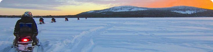 Early morning snowmobile tour on Pyhuajärvi lake, Lapland. Best way to start the day!