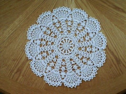 "Hand Crochet Doily - ""Lacy Fans"" Lacy Fans Doily was hand crochet in Ecru and measures 15 1/2 inches across. Created in the USA. PH-032 $55.00 + S/H **FREE SHIPPING ON ALL PURCHASES OF $25 OR GREATER."