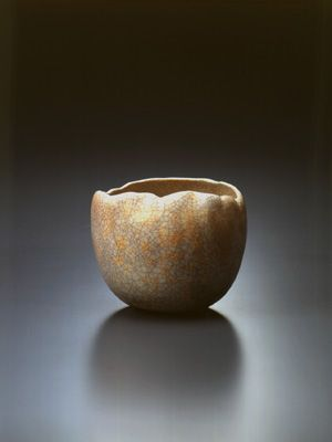 """RAKU WARE   Raku Museum-Collections:Kichizaemon XV (1949 ~ ) Raku tea bowl with reki glaze named """"Rika"""" authenticated by Jimyôsai (made in 1998) Its globular shape comfortably fit in the cupped hands as well as the white glaze texture tinged with red endows the bowl a warm and gentle charm. The glazing is called """"reki"""" glaze invented by the current generation."""