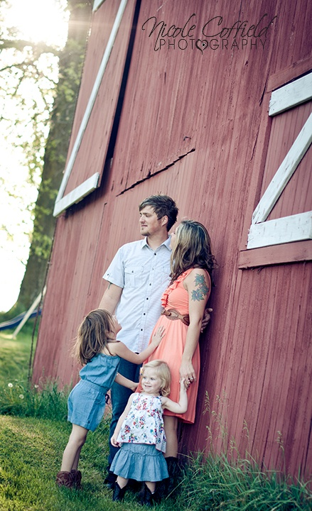 country vintage candid family photography with a rustic barn setting
