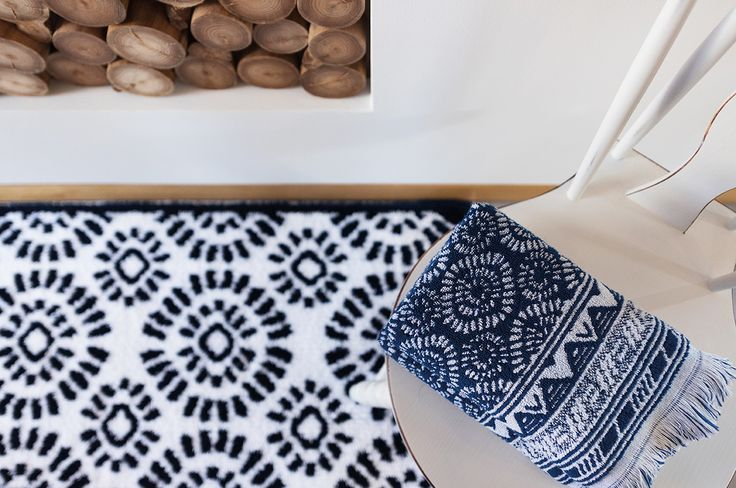 Indigo bath towels and bath rugs. Part of our Past Modern bath concept, which portrays rustic and ethnic scenes, creating a distinctive look with a traditional flavour.