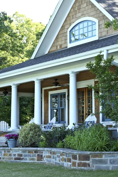 Cedar shingle siding, white trim, stone porch
