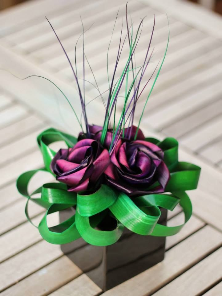 "Cube "" Mana"" centre piece in purple & bright green.                    www.flaxation.co.nz"