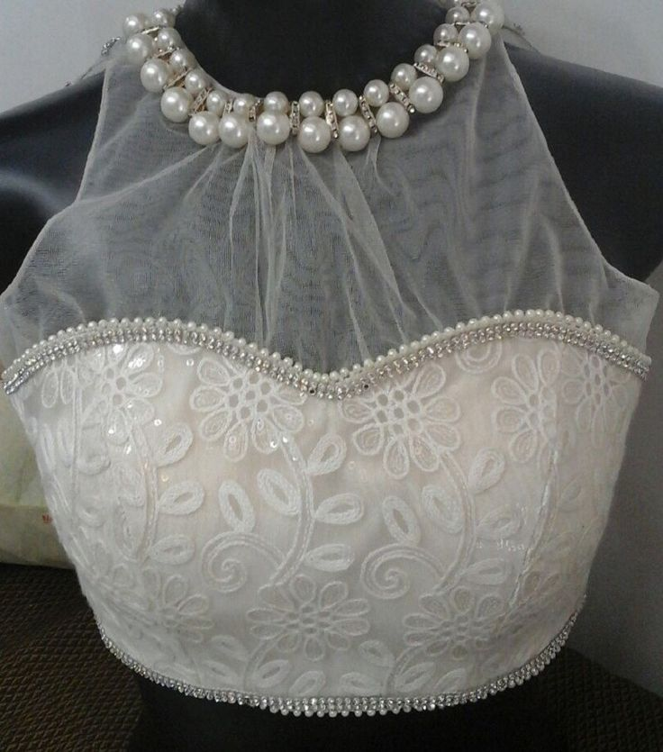 White Pearl necklace blouse - Party wear blouse that can be teamed with Silver / Black / Pink / Blue Saree or Indian Skirts. This is an anokherang creation - for complete collection logon to www.anokherang.com.