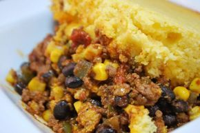 Lay down a bed of chili mixed with black beans and fresh corn, pave it over with a solid layer of light fluffy cornbread mix, pop it in the oven and when it's done you've got yourself a Cornbread Casserole, better know by me as a Tamale Pie! My Aunt Cash Anne's favorite dish as far as I was concerned.
