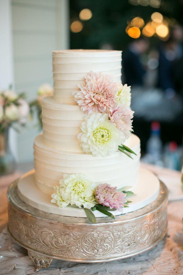 Three tier carnation topped wedding cake: http://www.stylemepretty.com/california-weddings/sebastopol/2017/01/26/this-pretty-vineyard-affair-wins-all-the-awards/ Photography: Jennifer Bagwell - http://jenniferbagwell.com/