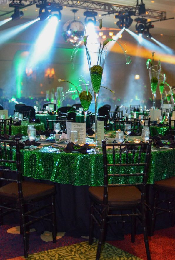 Wizard of Oz - Emerald City inspired tables. Using green sequined linen