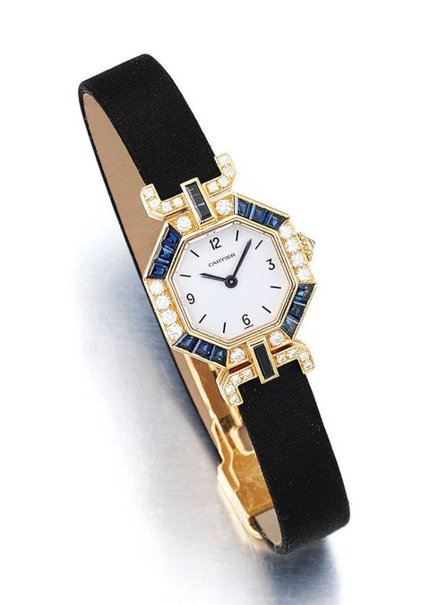 LADY'S SAPPHIRE AND DIAMOND WRISTWATCH, CARTIER.   The hexagonal dial framed by calibré-cut sapphires and brilliant-cut diamonds to silk straps, inner circumference approximately 173mm, signed Cartier and numbered, case stamped Cartier.