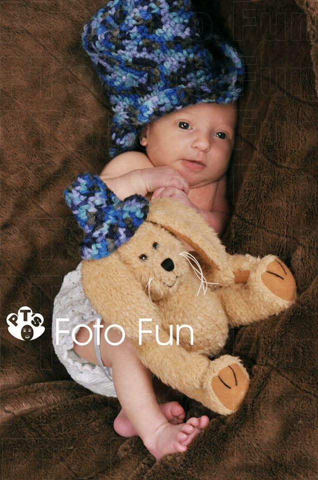 Newborn girl and teddy wih matching hats