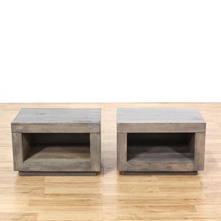This pair of nightstands is featured in a solid wood. Each contemporary style bedside table has a pull-out drawer, bottom open front cabinet, and plank top. Perfect on either side of the bed! #contemporary #dressers #nightstand #sandiegovintage #vintagefurniture