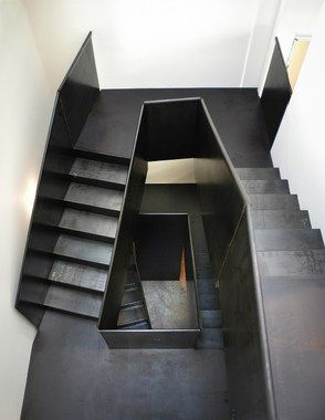 folded steel stair without stringers providing circulation & a 3D sculptural element by Olson Kundig Architects - Projects - Hot Rod House, Seattle