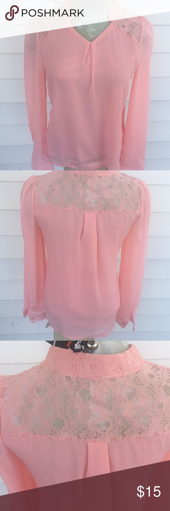 Peachy Lace Blouse This blouse is romantic & lace at it's finest. Notice the delicate lace at the sleeve and pearl and stone button. Smile Fish Tops Blouses