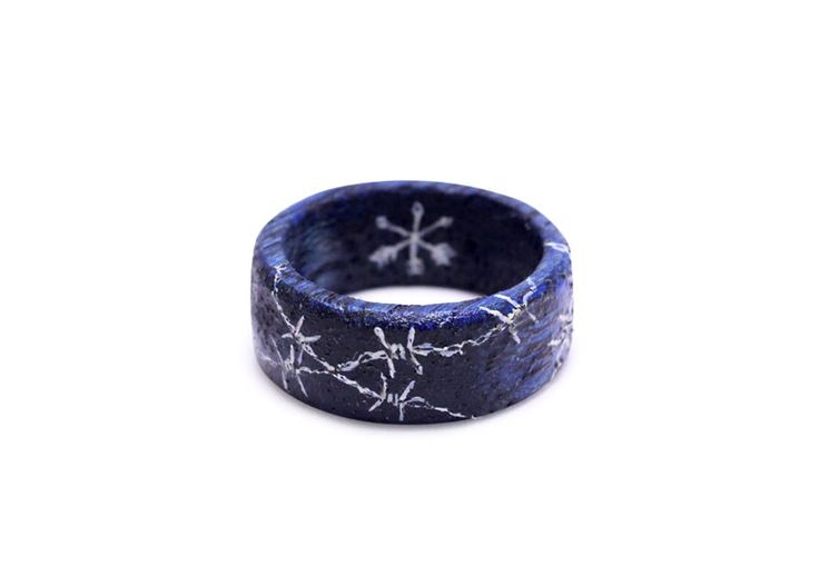 Hand painted barbed wire on wooden ring by Huntress & Hunter. Limited edition miniature wearable art pieces.