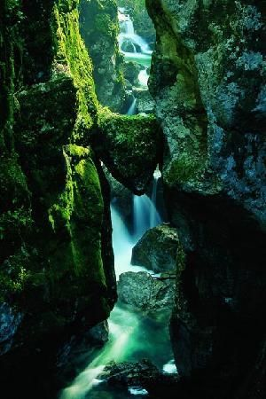 "Tolmin Gorge, Slovenia - I pretty much have this same picture, not nearly as pretty though.  I believe its called ""Bear's Head"" being the shape of the rock stuck between kinda looks like a bear."