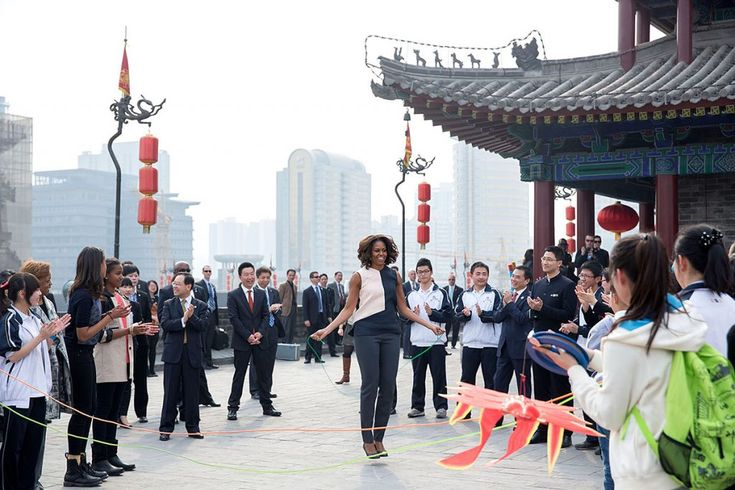 First Lady Michelle Obama, accompanied by daughters Sasha and Malia, and Marian Robinson, jumps rope as children demonstrate games during a visit to the City Wall in Xi'an, China, March 24, 2014. (Official White House Photo by Amanda Lucidon)  This official White House photograph is being made available only for publication by news organizations and/or for personal use printing by the subject(s) of the photograph. The photograph may not be manipulated in any way and may not be used in…