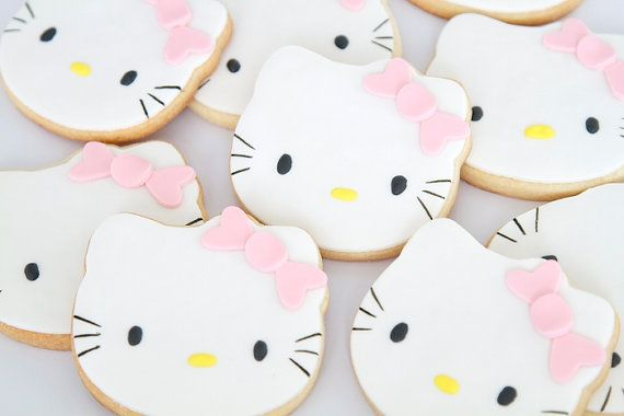 Precious Hello Kitty Cookies! My girls would love these..i need to work on my cookie art skills. (: