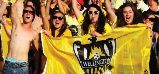 Wellington Phoenix football supporters a buzz in team colours.