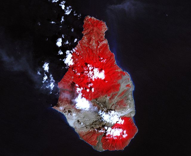 A massive eruption of Montserrat's Soufrière Hills Volcano covered large portions of the island in debris. The eruption was triggered by a collapse of Soufrière Hills' summit lava dome on February 11, 2010. Pyroclastic flows raced down the northern flank of the volcano, leveling trees and destroying buildings in the village of Harris, which was abandoned after Soufrière Hills became active in 1995. The Montserrat Volcano Observatory reported that some flows, about 15 meters (49 feet) thick…