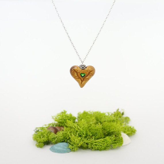 Hey, I found this really awesome Etsy listing at https://www.etsy.com/listing/270458174/heart-pendant-avocado-seed-pendant