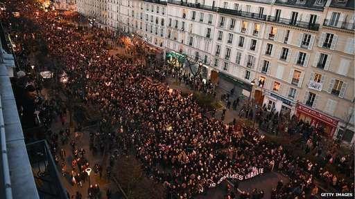 Demonstrators make their way down Boulevard Voltaire in Paris