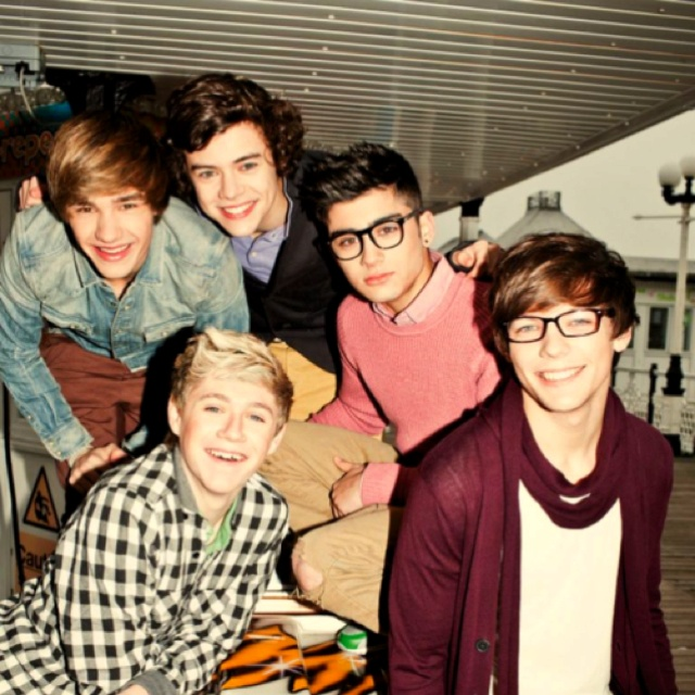 One Direction.  Louis looks so cute...