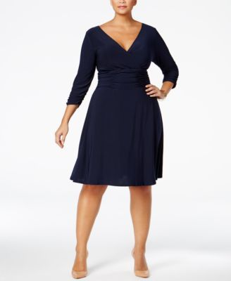 Look sensational in Ny Collection's A-line plus size dress, featuring a flattering ruched waist. | Polyester/spandex | Machine washable | Imported | Surplice neckline | Pullover style; no closures | T