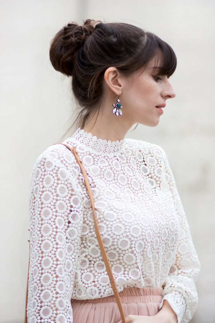 9a0a40be0577 Jeans and a Teacup wearing statement earrings and a high neck crochet top  with blush pleated skirt