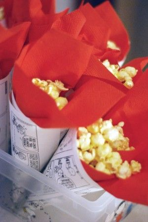 Gourmet popcorns--carmel, sweet kettle corn, served in sports newspaper page cones and sport team colored napkin liners